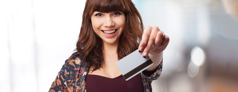 A girl with a travel credit card